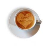 Copo de café com um coração e um scripture do bom dia fotografia de stock royalty free