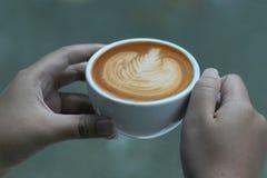 copo de café da posse da mão Foto de Stock