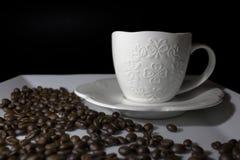 Copo de café e feijões de café Fotografia de Stock