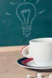 Copo de café e ideia do negócio na tabela de madeira Foto de Stock Royalty Free