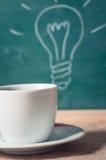 Copo de café e ideia do negócio na tabela de madeira Fotos de Stock Royalty Free