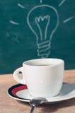 Copo de café e ideia do negócio na tabela de madeira Fotografia de Stock Royalty Free