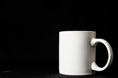 Copo de café isolado no preto Fotografia de Stock