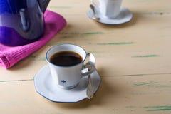Copo de café na tabela de madeira Fotos de Stock Royalty Free