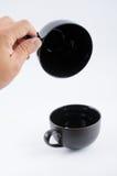 Copo de café preto no branco Foto de Stock