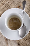 Copo de café vazio com uma colher Imagem de Stock