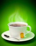Copo de chá com colher Fotos de Stock Royalty Free