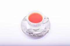 Copo de chá com colher Imagens de Stock