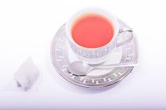 Copo de chá com saquinho de chá e colher Fotos de Stock Royalty Free