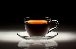 Copo de chá no fundo abstrato Imagens de Stock
