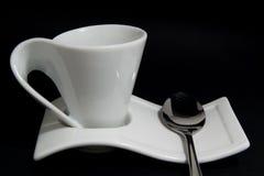 Copo de Coffe com colher Fotografia de Stock