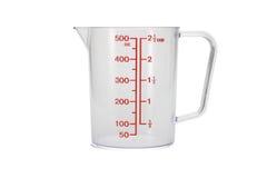 Copo de medição plástico da cozinha Fotos de Stock Royalty Free