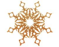 Copo de nieve del oro en blanco Foto de archivo libre de regalías