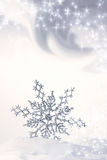 Copo de nieve en el azul de la nieve Foto de archivo libre de regalías
