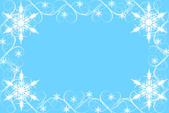 Copo de nieve y frontera del remolino en fondo azul imagenes de archivo