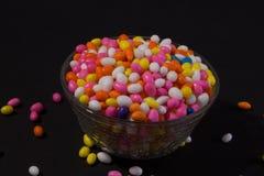 Copo de Sugar Coated Colorful Fennel Seeds imagem de stock