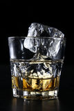 Copo de vidro com uísque Foto de Stock Royalty Free