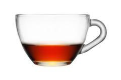 Copo de vidro meio cheio do chá no fundo branco isolado Imagem de Stock Royalty Free