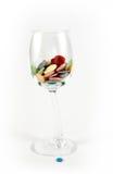 Copo de vinho e botões Fotografia de Stock Royalty Free