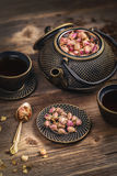 Copo do bule quente do chá e do ferro Foto de Stock