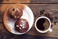 Copo do café e do queque quentes Fotografia de Stock Royalty Free