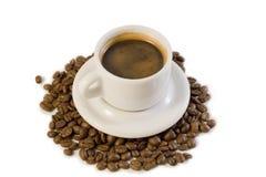 Copo do café em feijões de café Imagens de Stock Royalty Free