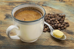 Copo do café gordo com manteiga Imagens de Stock Royalty Free