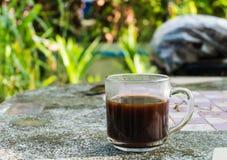 Copo do café preto na tabela de pedra Foto de Stock