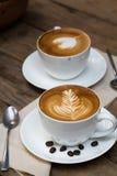 Copo do café quente da arte do latte Imagens de Stock Royalty Free