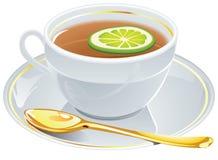 Copo do chá com colher dourada. Fotos de Stock