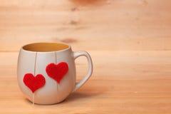 Copo do chá com corações Imagem de Stock