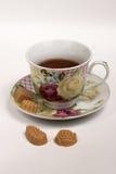 Copo do chá com doces Fotografia de Stock Royalty Free