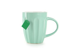 Copo do chá com o saquinho de chá isolado no fundo branco Imagem de Stock Royalty Free