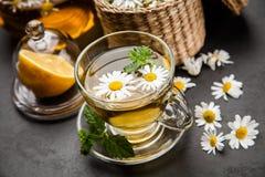 Copo do chá de camomila Imagem de Stock Royalty Free