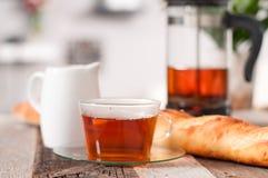 Copo do chá e do bule Imagens de Stock