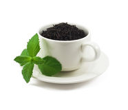 Copo do chá preto com folha da hortelã Foto de Stock Royalty Free