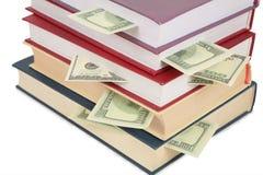 Copo dos livros com dólares Fotografia de Stock Royalty Free