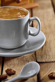 Copo e colher do coffe do Close-up Imagem de Stock