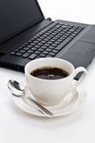 Copo e computador de café Imagens de Stock