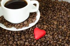 Copo e coração de café Fotografia de Stock