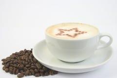 Copo e estrela de café Fotografia de Stock Royalty Free