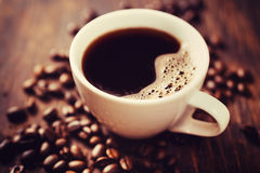 Copo e feijões de café Imagens de Stock Royalty Free