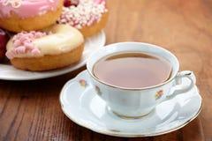 Copo e filhóses de chá Foto de Stock