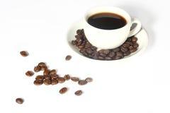 Copo e grão de café Imagem de Stock Royalty Free