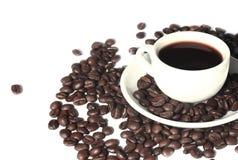 Copo e grão de café Imagens de Stock Royalty Free