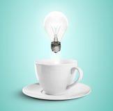 Copo e lâmpada Imagens de Stock