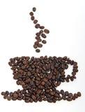 Copo e Saucer de café feitos de feijões de café Foto de Stock