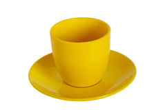 Copo e saucer de chá amarelos. foto de stock