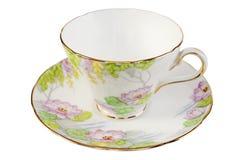 Copo e Saucer de chá antigos velhos imagens de stock