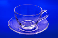Copo e saucer de vidro vazios Foto de Stock Royalty Free
